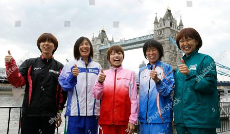 Japan's elite athletes Chika Horie, left, Yukiko Akaba, second left, Remi Nakazato, centre, Mai Ito, second right, and Yoko Shibui, right, pose for the media in front of Tower Bridge in London, . The London Marathon will go ahead on Sunday despite security fears in the wake of the bomb blasts in the Boston race that killed at least three people and injured many more