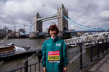 Japanese marathon runner Yoko Shibui poses for photographs during a media opportunity for the London Marathon backdropped by Tower Bridge in London, . The London Marathon will go ahead on Sunday despite security fears in the wake of the bomb blasts in the Boston race that killed at least three runners and injured many more