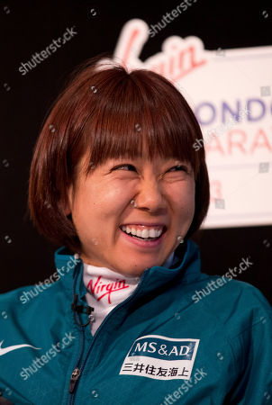 Japanese marathon runner Yoko Shibui laughs as she answers a question during a press conference for the London Marathon in London, . The London Marathon will go ahead on Sunday despite security fears in the wake of the bomb blasts in the Boston race that killed at least three runners and injured many more