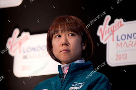 Japanese marathon runner Yoko Shibui waits her turn to speak at the start of a press conference for the London Marathon in London, . The London Marathon will go ahead on Sunday despite security fears in the wake of the bomb blasts in the Boston race that killed at least three runners and injured many more