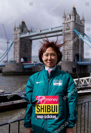 Stock Photo of Japanese marathon runner Yoko Shibui poses for photographs during a media opportunity for the London Marathon backdropped by Tower Bridge in London, . The London Marathon will go ahead on Sunday despite security fears in the wake of the bomb blasts in the Boston race that killed at least three runners and injured many more
