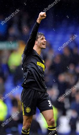 Wigan Athletic's Paul Scharner celebrates after the final whistle during their English FA Cup sixth round soccer match against Everton at Goodison Park in Liverpool, England