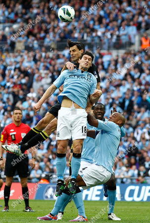 Stock Picture of Gareth Barry, Paul Scharner Manchester City's Gareth Barry, top front, competes with Wigan Athletic's Paul Scharner, top back, during their English FA Cup final soccer match at Wembley Stadium, London