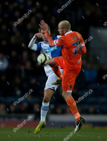 Blackburn's Morten Gamst Pedersen, left, fights for the ball against Millwall's Jack Smith during their English FA Cup quarterfinal replay soccer match at Ewood Park Stadium, Blackburn, England