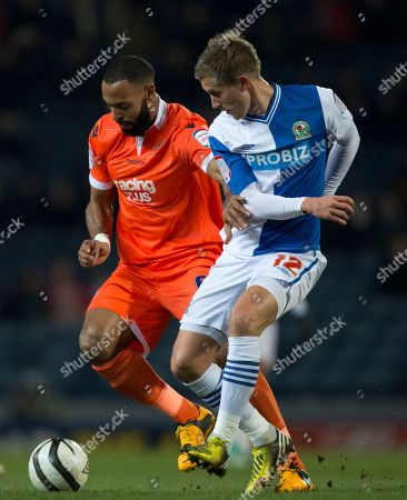Blackburn's Morten Gamst Pedersen, right, fights for the ball against Milwall's Liam Trotter during their English FA Cup quarterfinal replay soccer match at Ewood Park Stadium, Blackburn, England