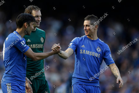 Chelsea's Fernando Torres, right, of Spain, celebrates with his teammates Paulo Ferreira, left, and Petr Cech during a ceremony to celebrate the Europa League cup win, following their English Premier League soccer match against Everton at the Stamford Bridge ground in London, . Chelsea won the Europa League cup by beating Benfica 2-1 in Amsterdam, Netherlands on May 15, 2013