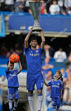 Chelsea's Paulo Ferreira lifts the Europa League cup following their English Premier League soccer match against Everton at the Stamford Bridge ground in London, . Chelsea won the Europa League cup by beating Benfica 2-1 in Amsterdam, Netherlands on May 15, 2013