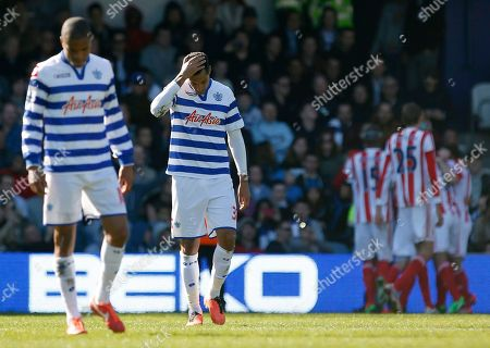 Jay Bothroyd, Loic Remy Queens Park Rangers' Jay Bothroyd, second left, and Loic Remy, left, react as Stoke City's players, right, celebrate Jonathan Walters' penalty goal during their English Premier League soccer match at Loftus Road stadium, London