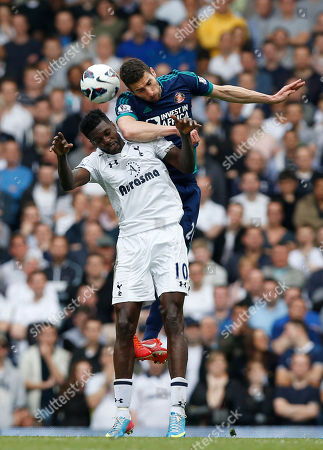 Emmanuel Adebayor, Carlos Cuellar Tottenham Hotspur's Emmanuel Adebayor, left, competes with Sunderland's Carlos Cuellar during their English Premier League soccer match at White Hart Lane, London