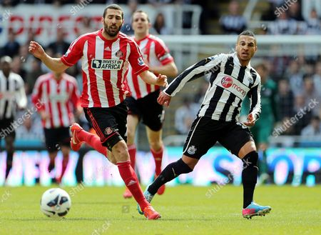 Newcastle United's Sylvain Marveaux, right, vies for the ball with Sunderland's Carlos Cuellar, left, during their English Premier League soccer match at St James' Park, Newcastle, England