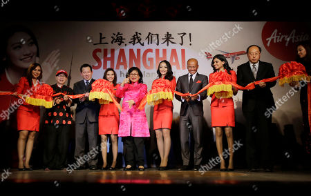 Azran Osman-Rani, Tan Sri Rafidah Aziz AirAsia X CEO Azran Osman-Rani, fourth from right, and Chairman Tan Sri Rafidah Aziz, fifth from left, attend a ribbon-cutting ceremony to celebrate budget carrier AirAsia's inaugural flight to Shanghai, in Shanghai, China on
