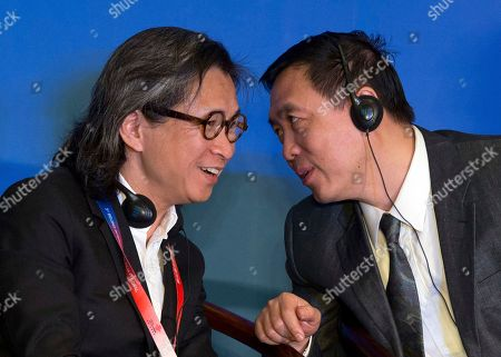 Peter Chan, Zhang Hongsen Hong Kong film director Peter Chan, left, chats with Zhang Hongsen, deputy director of China State Film at the Sino-Foreign Film Co-Production Forum of the Beijing International Film Festival in Beijing