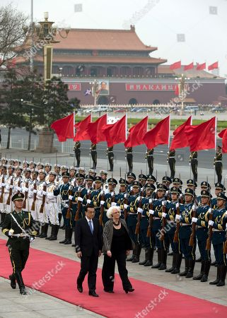 Johanna Sigurdardottir, Li Keqiang Iceland's Prime Minister Johanna Sigurdardottir, right, is escorted by Chinese Premier Li Keqiang as they inspect a guard of honor during a welcome ceremony outside the Great Hall of the People in Beijing