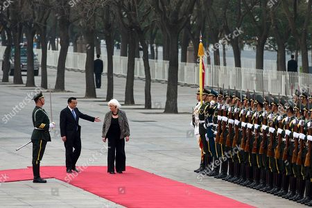 Johanna Sigurdardottir, Li Keqiang Chinese Premier Li Keqiang, second from left, shows the way to Iceland's Prime Minister Johanna Sigurdardottir as they prepare to inspect an honor guard during a welcome ceremony outside the Great Hall of the People in Beijing