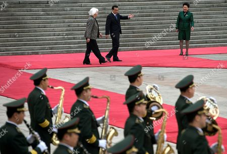 Johanna Sigurdardottir, Li Keqiang Chinese Premier Li Keqiang, center, shows the way to Iceland's Prime Minister Johanna Sigurdardottir, left, after inspecting an honor guard during a welcome ceremony outside the Great Hall of the People in Beijing