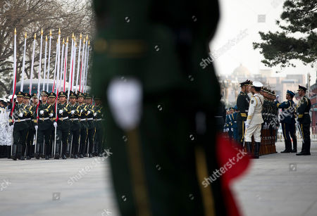 Chinese honor guards rehearse before a welcome ceremony for Iceland's Prime Minister Johanna Sigurdardottir outside the Great Hall of the People in Beijing