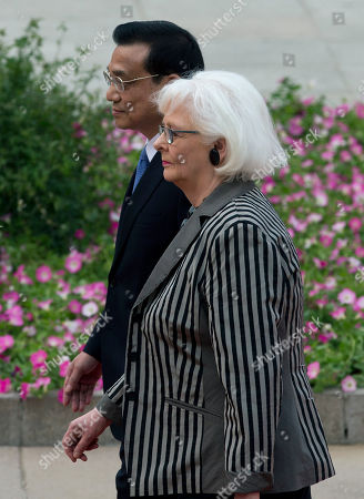 Stock Image of Johanna Sigurdardottir, Li Keqiang Iceland's Prime Minister Johanna Sigurdardottir, right, walks with Chinese Premier Li Keqiang after inspecting an honor guard during a welcome ceremony outside the Great Hall of the People in Beijing