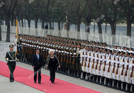 Stock Photo of Johanna Sigurdardottir, Li Keqiang Iceland's Prime Minister Johanna Sigurdardottir, right, and Chinese Premier Li Keqiang inspect a guard of honor during a welcome ceremony outside the Great Hall of the People in Beijing