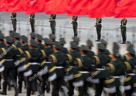 Chinese honor guards prepare for a welcome ceremony for Iceland's Prime Minister Johanna Sigurdardottir outside the Great Hall of the People in Beijing
