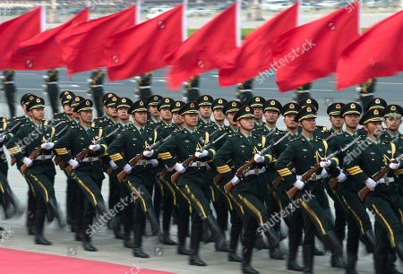 Chinese honor guards march during a welcome ceremony for Iceland's Prime Minister Johanna Sigurdardottir outside the Great Hall of the People in Beijing