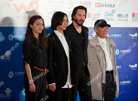 """Stock Photo of Keanu Reeves, Chen Hu, Ye Qing, Yuen Woo Ping Actors from left, Ye Qing, Chen Hu, Keanu Reeves, and their action choreographer Yuen Woo Ping pose for photographers during a media conference of their new movie """"Man of Tai Chi"""" in Beijing"""