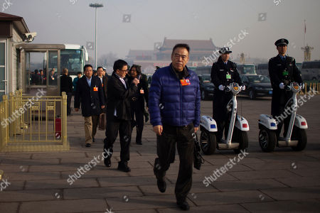 Chen Kaige, Jacky Chan Movie director Chen Kaige, center, and actor Jackie Chan, behind Chen, walk on Tiananmen Square to attend a plenary session of Chinese People's Political Consultative Conference (CPPCC), the government's top advisory body, held in the nearby Great Hall of the People, in Beijing China
