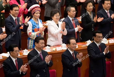 Xi Jinping, Hun Jintao, Wen Jiabao, Li Keqiang Chinese leaders from below left, former President Hu Jintao, newly installed President Xi Jinping, former Premier Wen Jiabao and newly appointed Premier Li Keqiang, applaud upon arrival at the closing ceremony of the National People's Congress at the Great Hall of the People in Beijing . China's new leaders pledged to run a cleaner, more efficient government and slash spending on official perks Sunday as the ceremonial legislature wrapped up a pivotal session to install a new leadership in a once-a-decade transfer of power
