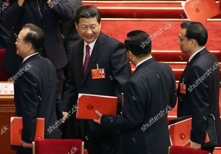 Wen Jiabao, Xi Jinping, Jia Qinglin, Li Kiqiang From left, China's former Premier Wen Jiabao, newly installed President Xi Jinping, former chairman of the Chinese People's Political Consultative Conference Jia Qinglin and newly appointed Premier Li Kiqiang leave after the closing session of the National People's Congress at the Great Hall of the People in Beijing China, . Xi pledged a cleaner, more efficient government Sunday as the country's ceremonial legislature wrapped up a pivotal session that installed the latest generation of communist leaders in a once-a-decade transfer of power