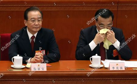 Li Kiqiang, Wen Jiabao China's newly appointed Premier Li Kiqiang, right, and former Premier Wen Jiabao attend the closing session of the National People's Congress at the Great Hall of the People in Beijing, China, . China's new leader Xi Jinping pledged a cleaner, more efficient government Sunday as the country's ceremonial legislature wrapped up a pivotal session that installed the latest generation of communist leaders in a once-a-decade transfer of power