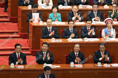 Hu Jintao, Xi Jinping, Li Kiqiang, Wen Jiabao Front row from left, China's former President Hu Jintao, newly installed President Xi Jinping, newly appointed Premier Li Kiqiang and former Chinese Premier Wen Jiabao clap at the closing session of the National People's Congress at the Great Hall of the People in Beijing China, . Xi pledged a cleaner, more efficient government Sunday as the country's ceremonial legislature wrapped up a pivotal session that installed the latest generation of communist leaders in a once-a-decade transfer of power