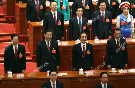 Hu Jintao, Xi Jinping, Li Kiqiang, Wen Jiabao Front row from left, China's former President Hu Jintao, newly appointed President Xi Jinping, newly installed Premier Li Kiqiang and former Chinese Premier Wen Jiabao sing the Chinese national anthem at the closing session of the National People's Congress at the Great Hall of the People in Beijing China, . China's new leader pledged a cleaner, more efficient government Sunday as the country's ceremonial legislature wrapped up a pivotal session that installed the latest generation of communist leaders in a once-a-decade transfer of power
