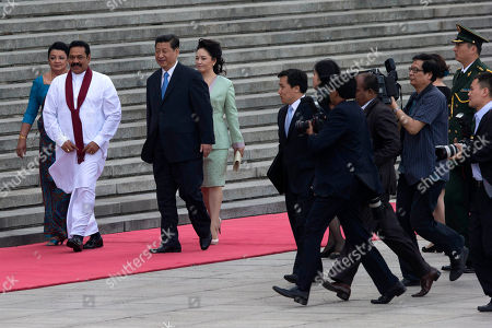Mahinda Rajapaksa, Xi Jinping Sri Lankan President Mahinda Rajapaksa, second from left walks with his wife Shiranthi Rajapaksa, left, with Chinese President Xi Jinping, center and his wife Peng Liyuan, center right, at the Great Hall of the People in Beijing, China
