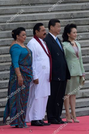 Mahinda Rajapaksa, Xi Jinping From right., wife of Chinese president Peng Liyuan, Chinese President Xi Jinping, Sri Lankan President Mahinda Rajapaksa and his wife Shiranthi Rajapaksa pose for a photo before a welcome ceremony at the Great Hall of the People in Beijing, China