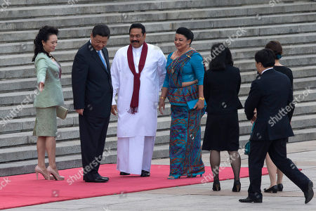 Xi Jinping, Mahinda Rajapaksa From left to right., Wife of Chinese president Peng Liyuan, Chinese President Xi Jinping, Sri Lankan President Mahinda Rajapaksa and his wife Shiranthi Rajapaksa arrive for a welcome ceremony at the Great Hall of the People in Beijing, China