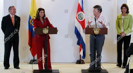 Juan Manuel Santos, Laura Chichilla, EnriqueCastillo, Maria Angela Holguin Colombia's President Juan Manuel Santos, second right, looks over at Costa Rica's President Laura Chinchilla as he delivers a speech delivers a speech after the two leaders signed a Free Trade Agreement in Cali, Colombia, . Some of Latin America's presidents, including Mexico, Chile, Colombia, Costa Rica and Peru, are looking to decrease trade barriers as they gather in Cali for the two-day summit. Also pictured are Costa Rica's Foreign Minister Enrique Castillo, left, and Colombia's Foreign Minister Maria Angela Holguin, right
