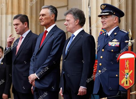 Juan Carlos Pinzon, Anibal Cavaco Silva, Juan Manuel Santos, Jose Javier Perez Colombia's Defense Minister Juan Carlos Pinzon, left, Portuguese President Anibal Cavaco Silva, second left, Colombia's President Juan Manuel Santos, second right, and Colombia's military's Chief of Staff Gen. Jose Javier Perez, listen to military honors during a welcoming ceremony to Cavaco at the Presidential Palace in Bogota, Colombia, . Cavaco started Monday a three-day state visit to Colombia