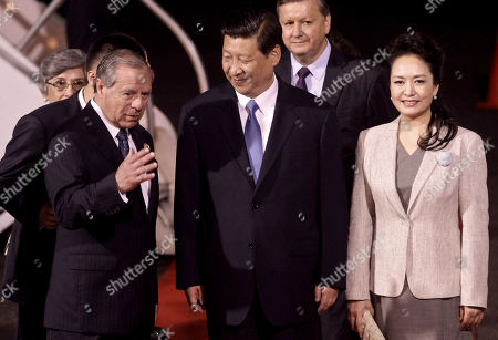 Xi Jinping, Peng Liyuan, Enrique Castillo China's President Xi Jinping, center, and his wife Peng Liyuan, right, are welcomed by Costa Rica's Foreign Minister Enrique Castillo upon their arrival to San Jose, Costa Rica, . Xi is embarked on a tour of the Americas, visiting Trinidad & Tobago, Costa Rica Mexico and the US