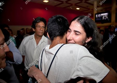 Yoani Sanchez, Teo Escobar Cuban dissident blogger Yoani Sanchez embraces her son Teo Escobar upon her arrival at the Jose Marti International Airport in Havana, Cuba, . Sanchez is back home after a more than three-month globe-trotting tour that has turned her into the most internationally recognizable face in the island's small dissident community. Sanchez has been on the road since Feb. 17 and visited more than a dozen countries in Europe and the Americas