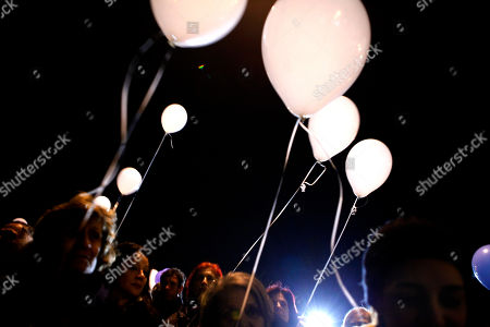 Demonstrators hold balloons as they gather outside Cyprus' presidential palace to celebrate the end of outgoing President Dimitris Christofias' 5-year tenure in the capital Nicosia, . Many Cypriots accuse communist-rooted Christofias of five years of failed governance