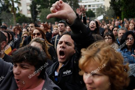 Stock Photo of An employee of Bank of Cyprus gestures and shouts during a protest at Cyprus central bank in capital Nicosia, Cyprus, . Cypriot businesses were under increasing strain to keep running on Tuesday after financial authorities stretched the country's bank closure into a second week amid fears that depositors will rush to drain their accounts