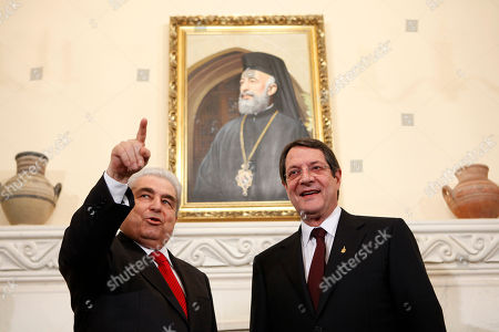 Dimitris Christofias, Nicos Anastasiades Outgoing President Dimitris Christofias, left, gestures as he greets his successor Nicos Anastasiades during an official transfer of power ceremony at the Presidential palace in divided Nicosia, Cyprus, . Anastasiades told parliament on Thursday that he wants to conclude a bailout agreement as soon as possible, but that doesn't mean accepting any writedown
