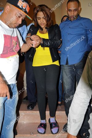 """Martha Heredia Dominican Republic's singer Martha Heredia, center, is escorted handcuffed into the prosecutor's office in Santiago, Dominican Republic, . Heredia, a winner of the TV talent show """"Latin American Idol"""", was arrested late Wednesday and charged with drug smuggling after police found heroin stuffed in the heels of her platform shoes as she was about to board a plane to New York at the Cibao International airport in Santiago, according to National Drug Control Agency Director Frank Duran"""