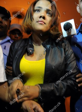 """Stock Photo of Martha Heredia Dominican Republic's singer Martha Heredia, is escorted handcuffed into the prosecutor's office in Santiago, Dominican Republic, . Heredia, a winner of the TV talent show """"Latin American Idol"""", was arrested late Wednesday and charged with drug smuggling after police found heroin stuffed in the heels of her platform shoes as she was about to board a plane to New York at the Cibao International airport in Santiago, according to National Drug Control Agency Director Frank Duran"""