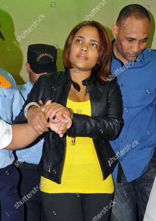 """Martha Heredia Dominican Republic's singer Martha Heredia is escorted handcuffed into the prosecutor's office in Santiago, Dominican Republic, . Heredia, a winner of the TV talent show """"Latin American Idol"""", was arrested late Wednesday and charged with drug smuggling after police found heroin stuffed in the heels of her platform shoes as she was about to board a plane to New York at the Cibao International airport in Santiago, according to National Drug Control Agency Director Frank Duran"""