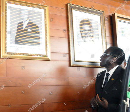 Robert Mugabe Zimbabwe's President Robert Mugabe looks at the pictures on the wall of former Malawi President Dr. Hastings Kamuza Banda, and Former Zambian President Kenneth Kaunda, at the African Union summit in Addis Ababa, Ethiopia . The African Union on Saturday marked 50 years since the founding of a continent-wide organization that helped liberate Africa from colonial masters and which now is trying to stay relevant on a continent regularly troubled by conflict