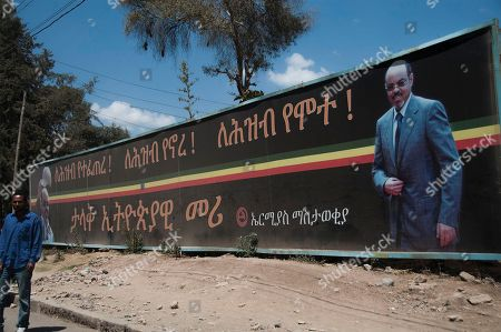 """A large bill board of late Prime Minister Meles Zenawi which reads in Amharic """"He was born for the people, he lived for the people, he died for the people. Great Ethiopian leader your vision will remain the national treasure. Hero will never die, we love you """" on one of the streets in Addis Ababa. If you look around Ethiopia's capital, it would be hard to know that Meles Zenawi died six months ago. His pictures are posted everywhere and his successor is vowing to implement his vision without any alternations. Ethiopian leaders are having a hard time moving past Meles, a man who ruled this country for two decades"""