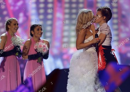 """Finland's Krista Siegfrids, second right, kisses a dancer as she performs her song """"Marry Me"""" during the second semifinal of the Eurovision Song Contest at the Malmo Arena in Malmo, Sweden. That was the first girl-on-girl kiss in the history of the annual competition. Previously, organizers had sought to prevent similar embraces citing the competition's status as a family event. The final of this year's Eurovision Song Contest is due to take place Saturday, May 14 in the Swedish capital Stockholm"""