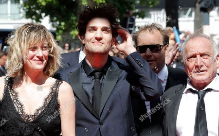 Louis Garrel, Valeria Bruni Tedeschi, Andre Wilms Cast, from left, director Valeria Bruni Tedeschi, Louis Garrel, and Andre Wilms arrive for the screening of A Castle in Italy at the 66th international film festival, in Cannes, southern France