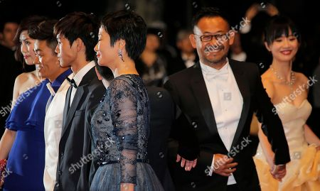 Cast, from left to right, Baoqiang Wang, Lanshan Luo, Tao Zhao, Jiang Wu and Meng Li pose for photographers as they arrive for the screening of film A Touch of Sin at the 66th international film festival, in Cannes, southern France
