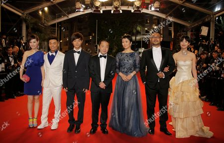 Cast from right, Meng Li, Jiang Wu, Tao Zhao, director Jia Zhangke, Lanshan Luo, Baoqiang Wang and an unidentified guest arrive for the screening of film A Touch of Sin at the 66th international film festival, in Cannes, southern France